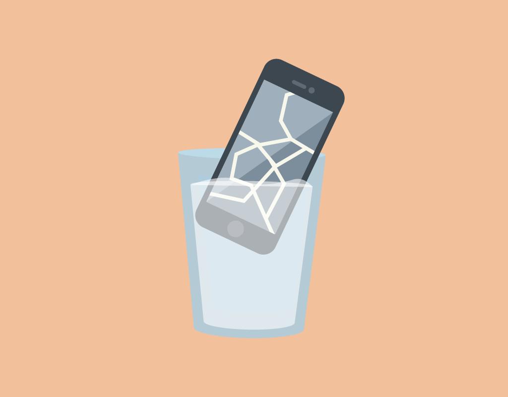 broken phone in a glass of water